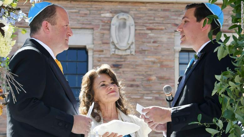 Colorado governor weds longtime partner in first same-sex marriage for a sitting governor