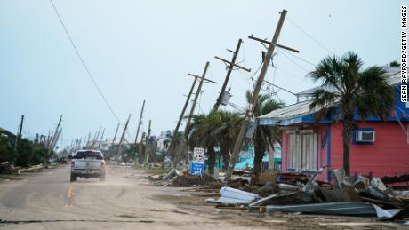 A motorist drives down a road in the wake of Hurricane Ida on September 4, 2021 in Grand Isle, Louisiana.