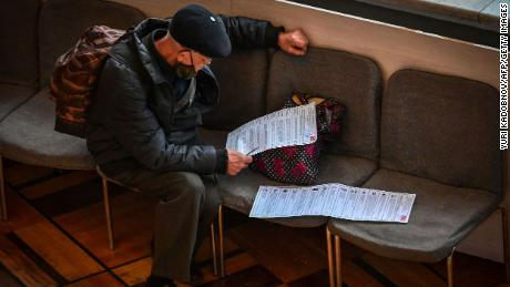 A man votes during the first day of the three-day election in Moscow on September 17.