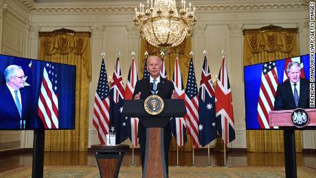 US President Joe Biden speaks on national security with British Prime Minister Boris Johnson, right, and Australian Prime Minister Scott Morrison, left, in East Room of the White House in Washington, DC, on September 15.