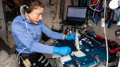 Christina Koch is shown working on the Genes In Space-6 experiment on the space station in 2019.