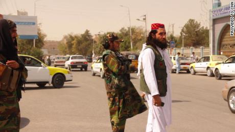 Taliban patrol the streets of Mazar-i-Sharif.