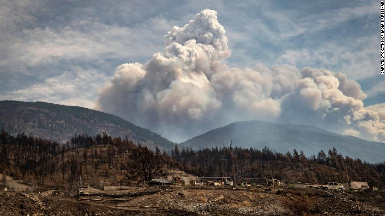 Properties destroyed by the Lytton Creek wildfire on June 30 are seen as a pyrocumulus cloud, also known as a fire cloud, produced by the same fire rises in the mountains above Lytton, British Columbia, on Sunday, Aug. 15, 2021.