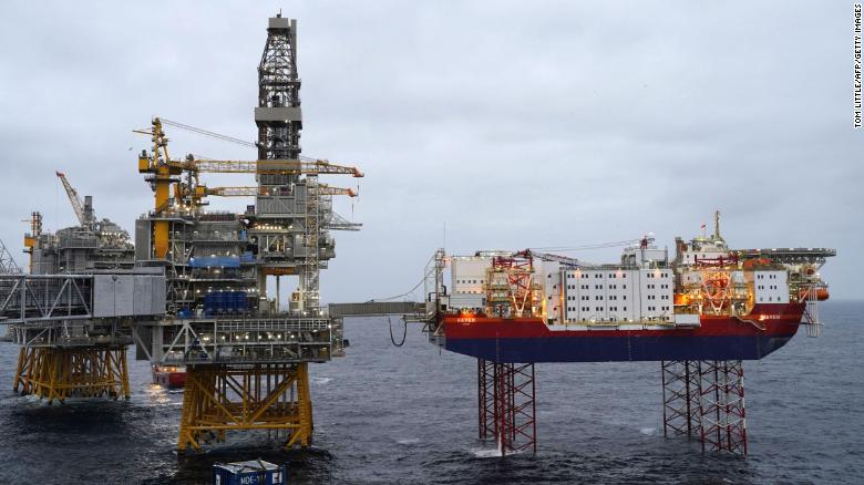 Platforms producing oil stand in the North Sea over the Johan Sverdrup oil field during a media visit to the area some 140 kilometers (87 miles) west from the city of Stavanger, Norway, on December 3, 2019.