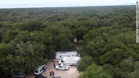 In this photo provided by the North Port Police Department, law enforcement officials conduct a search of the Carlton Reserve in the Sarasota, Florida, area for Brian Laundrie on Saturday.