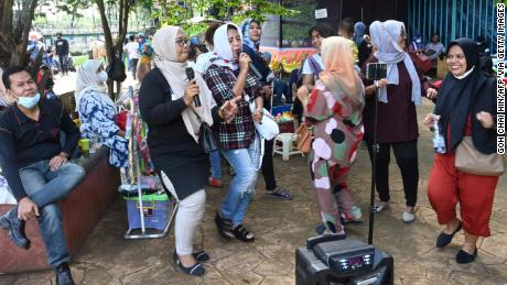 A group of residents gathering for an outdoor karaoke session at a park on the outskirts of Jakarta, Indonesia, on September 19.