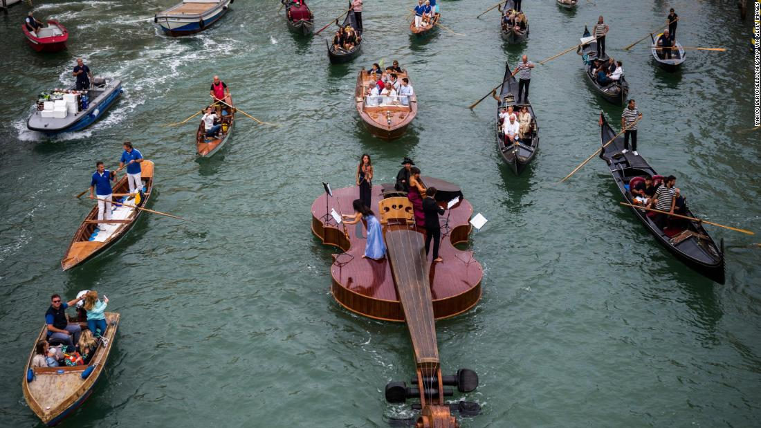Violin boat launched in Venice with string quartet performance – CNN Video