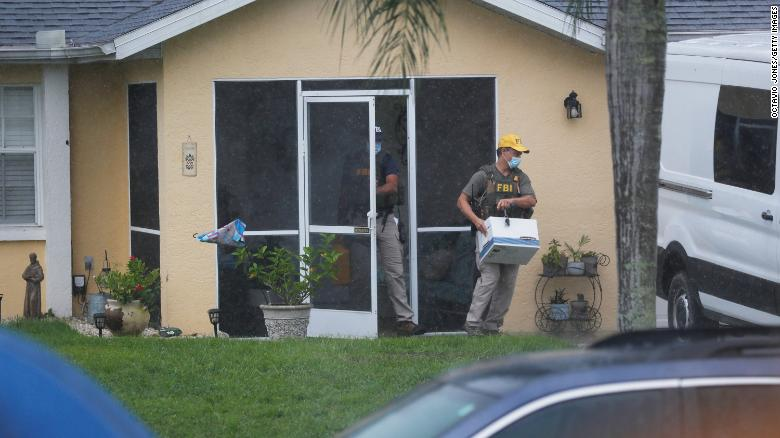 FBI agents remove possible evidence Tuesday from the family home of Brian Laundrie in North Port, Florida.