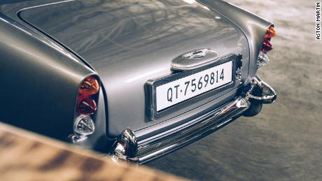 The miniature James Bond DB5 includes a changeable digital license plate and an exhaust pipe smokescreen feature.