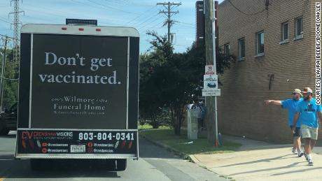 An advertising agency hired a truck to drive around Charlotte with a hidden message about vaccination.