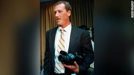 Holliday holds the videocamera he used to capture the Rodney King beating after a 1991 news conference.