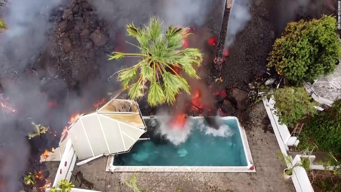 Swimming pool and homes swallowed by lava