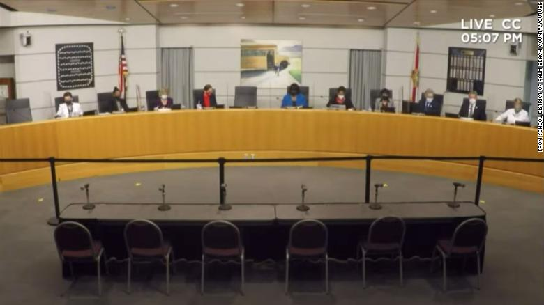 Heavy police presence at Florida school board meeting where mask wearers separated from those without masks