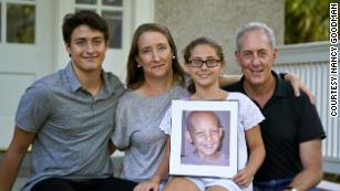 Nancy Goodman (second from left), with Ben (left), Sarah, husband Michael and a photo of Jacob.