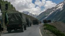 An Indian army convoy, carrying reinforcements and supplies, travels toward Leh through Zoji La, a high mountain pass bordering China on June 13 in Ladakh, India.