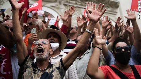Demonstrators protest against  Saied in Tunis on September 18.