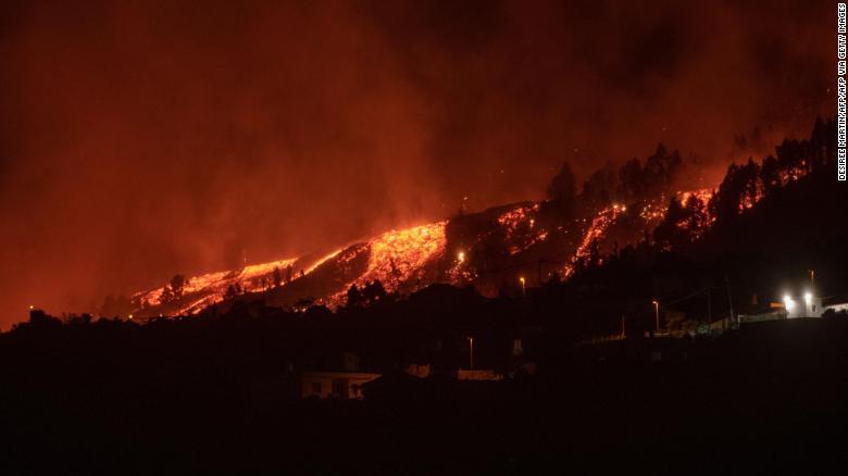 Authorities lock down coastal area in La Palma as lava approaches sea