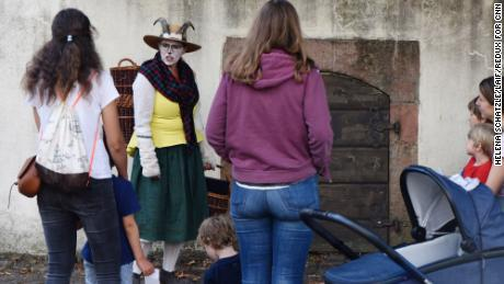 A storyteller dressed as a goat leads a tour of the Brothers Grimm House.