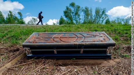 An overturned casket lays against Ironton's Mississippi River Levee on September 19.
