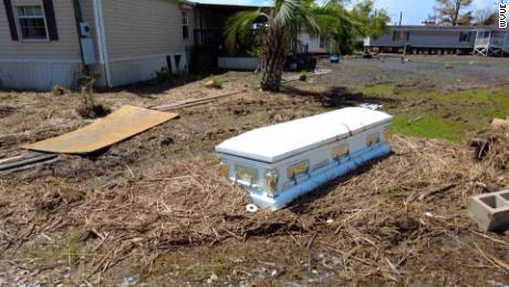 A casket sits near a home in Ironton, Louisiana.