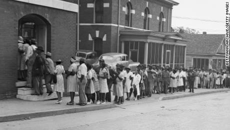 Despite being warned to keep away from the polls, thousands of Black residents turned out to vote in Democratic primaries held July 17, 1946, in Marietta, Georgia.