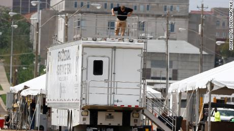 A worker secures a railing on a state-run mobile field hospital at the Mississippi State Fair Grounds on March 19, 2020, in Jackson.