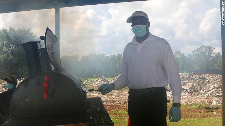 The school district's bus director volunteered to make burgers for kids who got vaccinated.