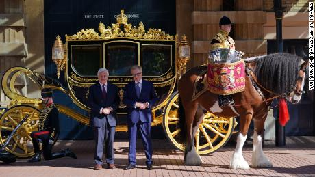 Simon Brooks-Ward, producer and director (right), and Mike Rake, chairman of the Platinum Jubilee's advisory committee, pose in front of the Diamond Jubilee State Coach during the media launch for the Queen's Platinum Jubilee celebration.