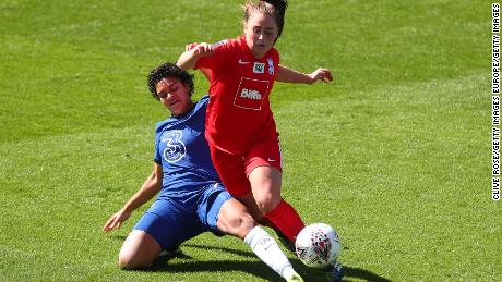 Chelsea;s Jess Carter of Chelsea tackles Jamie-Lee Napier of Birmingham City during the Women's Super League match at Kingsmeadow on April 4, 2021 in Kingston upon Thames.