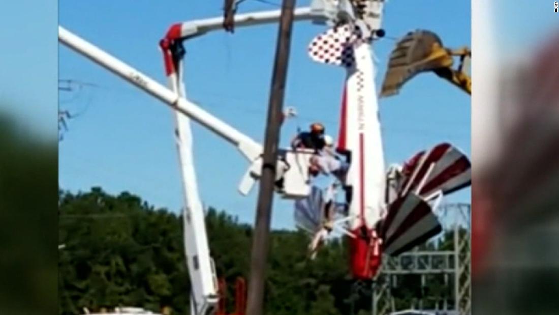 Pilot left dangling in power lines after crash