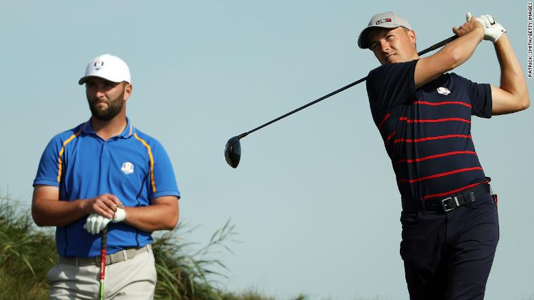 Spieth plays his shot from the 14th tee as Rahm looks on during Friday morning Foursome matches.