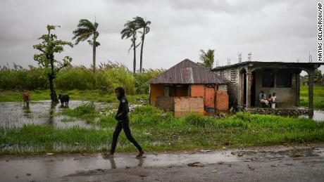 A man walks in an area that was flooded by Tropical Storm Grace, in Trou Mahot, Haiti, on August 17. The storm struck just days after a 7.2-magnitude earthquake.