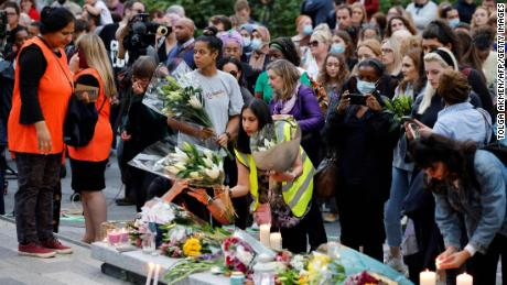 Well-wishers lay floral tributes ahead of a vigil for Nessa, whose body was found near the Onespace community centre in southeast London on September 24, 2021.