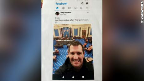 The criminal complaint included a screen shot from Facebook showing Mariotto in the Senate Chamber.
