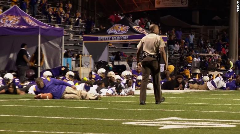 Shooting outside of Alabama high school football game halts the contest and causes alarm in the stands