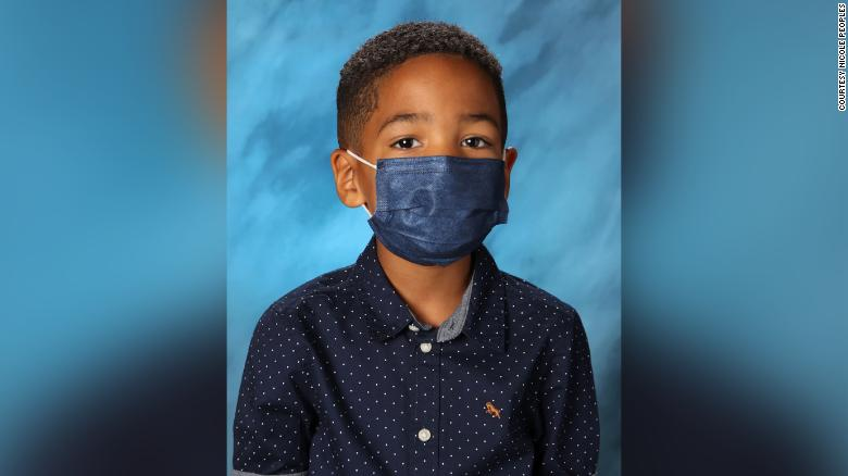 First grader wears mask for school picture because his mom told him not to take it off at school