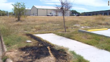 Three exhumed bodies, including a baby, were found in a burning Texas dumpster