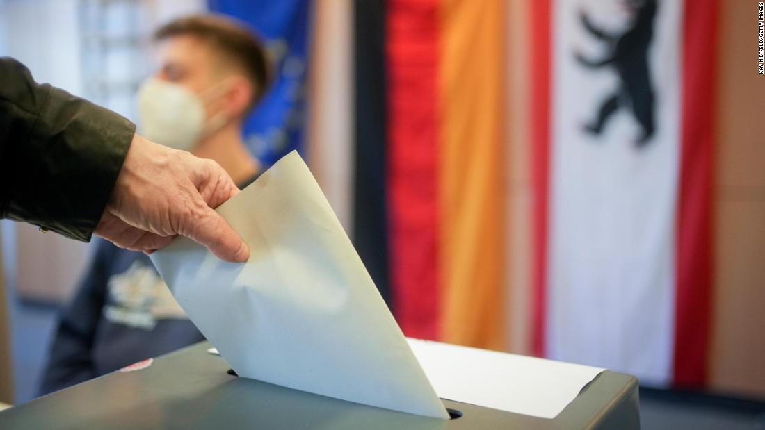 Exit polls show tight race to replace Merkel in Germany