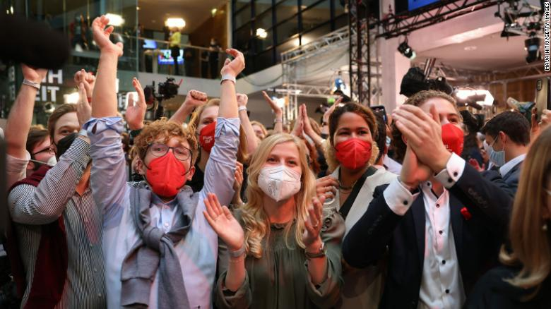 SPD members react to initial election results in Berlin on Sunday.