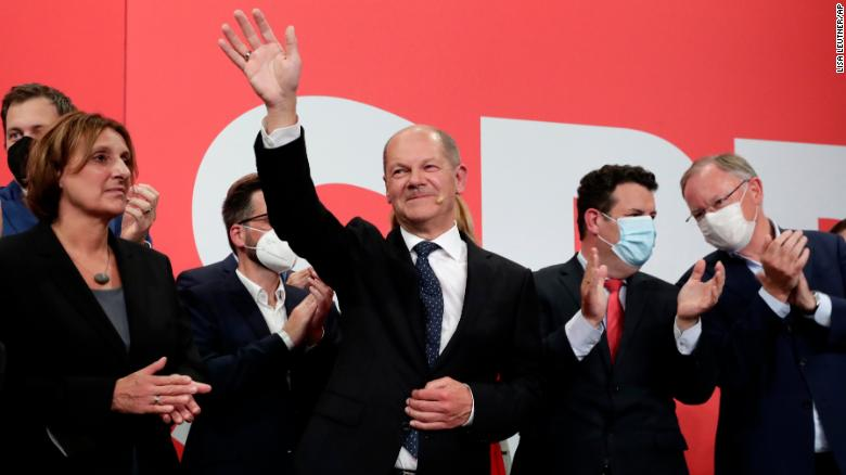 SPD leader Olaf Scholz waves to supporters at the party's headquarters in Berlin, on September 26.