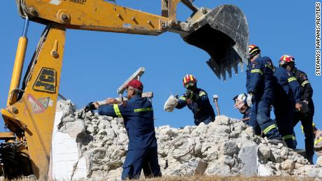 Firefighters search for people in the rubble of a church demolished after the earthquake.