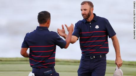 Schauffele (left) and Johnson celebrate on the 17th green during Friday afternoon's fourball matches.