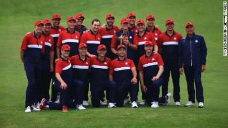 Team US celebrates with the Ryder Cup after defeating Team Europe.