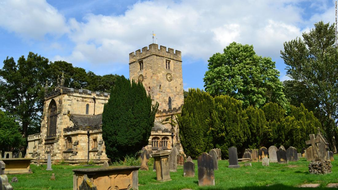 Church's beer festival sparks outrage after visitors pose with drinks on gravestones