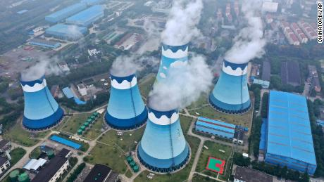 Steam billows out of the cooling towers at a coal-fired power station in Nanjing, China.