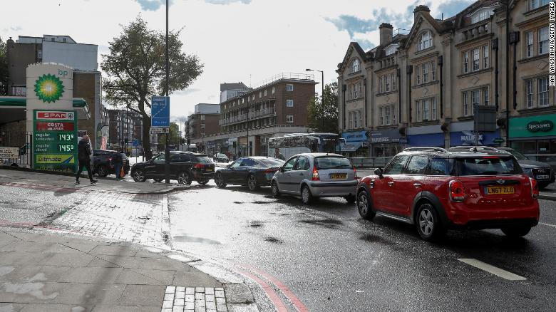 Vehicles are seen outside a petrol station in London on September 27.
