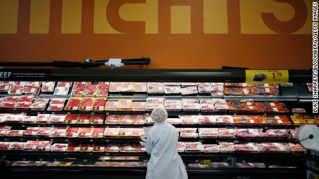 An employee replenishes shelves with pork in the meat section of a Kroger Co. supermarket in Louisville, Kentucky, United States on Tuesday, March 5, 2019. Kroger Co. is expected to release its results on March 7.