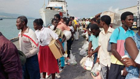 After being deported from Guantanamo Bay in Cuba in February 1992, the Haitian refugees disembarked from a U.S. Coast Guard ship.