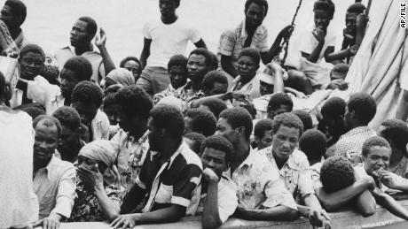 October 1.  In In Haiti, the Haitians arrived in Miami in a crowded sailboat.