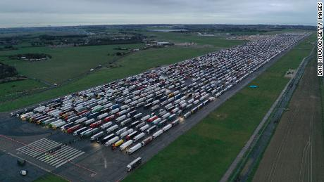 Trucks parked on the runway at Manston Airport in England wait to cross the Channel on December 22, 2020.
